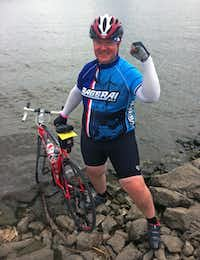 Dallas senior assistant attorney Don Knight, placed his front tire in the Mississippi River in the finishing city of Fort Madison during the Register's Annual Great Bicycle Ride Across Iowa.
