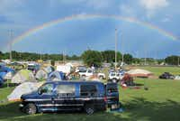 Riders set up campsites beneath a rainbow in Harlan, Iowa (they overnight more than triple the townÕs population) after the first dayÕs ride of the Register's Annual Great Bicycle Ride Across Iowa.