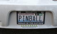 "In this Dec. 16, 2013 photo, a custom ""PINBALL"" vanity license plate is shown on a car owned by Charles and Cinty Martin, who own and operate the Seattle Pinball Museum."