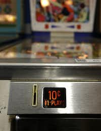 In this Dec. 16, 2013 photo, the 10-cent coin slot for an 1968 Fun Land pinball machine at the Seattle Pinball Museum in Seattle.