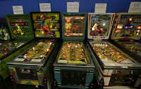 In this Dec. 16, 2013 photo, older pinball machines line a wall of the Seattle Pinball Museum in Seattle.