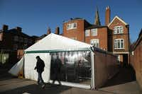 A tent sits over the spot where the remains of King Richard III were found in Leicester, England. The king's remains are to be re-intered at Leicester Catherdral.