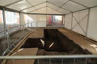 Under a tent in Leicester, England, is the excavation spot where the remains of King Richard III were found, in a parking lot.