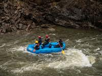 Rafters splash down the the Arkansas River in Colorado. The route through Royal Gorge features some of Colorado's finest whitewater.