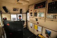 Engineer trainee Devon Cacy sits at the controls. The locomotive cab may not be fancy, but it's pleasantly spacious and comfortable.