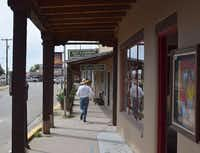 Robert Parsons , owner of Parsons Gallery of the West, strolls past the art galleries along Kit Carson Road in Taos, N.M.John Lumpkin - Special Contributor