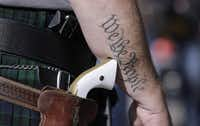 Scott Smith, a supporter of open carry gun laws, wore a pistol as he prepared for a rally at the CapitolonJan. 26 in Austin.(Eric Gay - The Associated Press)