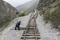 Crew members conduct safety checks before Tren Crucero navigates the notorious Devil's Nose via a series of extreme switchbacks.Eric Mohl  -  Horizon Writers' Group