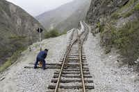 Crew members conduct safety checks before Tren Crucero navigates the notorious Devil's Nose via a series of extreme switchbacks.( Eric Mohl  -  Horizon Writers' Group )