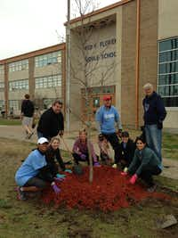 Members of the Mahatma Gandhi Memorial of North Texas committee plant 40 trees around the memorial at Thomas Jefferson Park in Irving.( Mahatma Gandhi Memorial of North Texas )