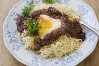 Eggs in Puttanesca with Angel Hair Pasta(Matthew Mead - AP)