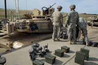 First Infantry Division soldiers resupply their tanks after a live fire exercise at Fort Riley, Kan. This summer, nearly two dozen of the unit's soldiers deployed to Niger, in West Africa, to help train troops for U.N. peacekeeping duty in neighboring Mali.