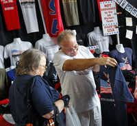 Vendor Ron Krohn showed American-made T-shirts to Loella Weeks of Tulsa, Okla., at Glenn Beck's Restoring Love event Friday.