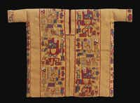 """Miniature tunic with weapon(?)-bearing creature in profile; camelid fiber and cotton from """"Wari: Lords of the Ancient Andes"""""""