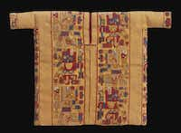 "Miniature tunic with weapon(?)-bearing creature in profile; camelid fiber and cotton from ""Wari: Lords of the Ancient Andes"""
