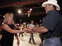 Cliff and Lee Ann Morris  dance during a class led by Wendell Nelson at Billy Bob's. Cliff and Lee Ann met while dancing at Billy Bob's in 1997 and married in 2009.(Brandon Wade - Special Contributor)