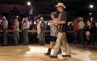 "Wendell Nelson  and his assistant for over 20 years, Rhonda Autry, explain how to dance to the ""Cotton-eyed Joe"" during a beginner class at Billy Bob's Texas in Fort Worth. Nelson offers line-dance lessons on Thursday nights and beginner lessons on Sundays and Mondays.Photos by Brandon Wade - Special Contributor"