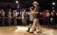 "Wendell Nelson  and his assistant for over 20 years, Rhonda Autry, explain how to dance to the ""Cotton-eyed Joe"" during a beginner class at Billy Bob's Texas in Fort Worth. Nelson offers line-dance lessons on Thursday nights and beginner lessons on Sundays and Mondays.(Photos by Brandon Wade - Special Contributor)"