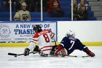 Taylor Lipsett battles for the puck during a game in Charlotte in January on the road to the 2014 Sochi Paralympic Games. His team's first game is Saturday.(Meredith Nierman - WGBH)