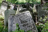 Fanciful art and mythical creatures adorn some of the tumbling old tombstones in this Jewish graveyard in western Ukraine.