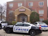Dallas Police investigate a double shooting at a hotel at 10326 Finnell Street near Northwest Highway and Stemmons Tuesday morning December 9, 2014. (Ron Baselice/Staff Photographer)