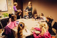 Stephanie Swain, River of Life Sunday School Director, left, and volunteer Elizabeth Vedernikov, work with children of Russian-speaking immigrants who attend the church.( Photo submitted by LEONID REGHETA  )