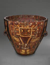 """Urn with staff deities; ceramic and slip from """"Wari: Lords of the Ancient Andes"""""""