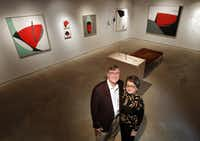 Kevin and Cheryl Vogel stand in one of the main gallery areas at Valley House Gallery and Sculpture Garden with paintings by Dallas born artist David A. Dreyer.