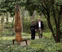 "Cheryl and Kevin Vogel take a walk through the sculpture garden. The sculpture (left) is ""Not-So-Perfect World"" by American born sculpture Deborah Ballard."