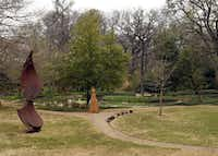 "As visitors view the small lake at the Valley House Gallery and Sculpture Garden they will see ""Wind Sweep"" by John Brough Miller (left) and ""Rethinking It All"" (center, left) by Deborah Ballard."