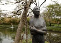 """""""Manipulated Pat #4"""", a sculpture by Deborah Ballard, made from cast stone, fiberglass, acid washes and wax is on display on a small island at the Valley House Gallery and Sculpture Garden."""