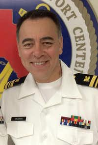 """Maj. Jimmy Vaughan, who oversees the Northwest Patrol Division and is a Navy Reserve lieutenant commander, says his police training benefited his military service. """"It helped me survive, knowing how to read people and why people behave the way they do,"""" he said.( Jimmy Vaughan )"""