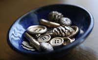 A selection of bronze buttons and other fired precious metal clay pieces made by Metal Clay Artist Jenny Vestal. Vestal uses bronze, fine silver and sterling silver clays to make most of her beautiful fired metal clay buttons, cuff links, shawl pins and many other very custom things.