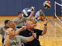 USA Sitting Volleyball Coordinator Elliot Blake (center) demonstrated a proper serve as wounded military veterans learned about opportunities in sports and recreation.