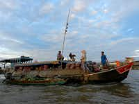 The Cai Rang market, a large wholesale floating market on the Hau River, was in full swing in Can Tho, Vietnam.