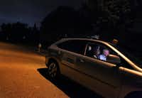 Paul Landfair (left) and Jim Thomas, make their Crime Watch patrol rounds in the Woodbriar neighborhood of North Dallas.