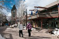 Visitors wander the Snowmass Village Mall, an area which features a handful of restaurants, specialty shops and real estate firms.