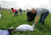 Amy Hardman picked up a pillow as she and other volunteers helped clean up Forney's Diamond Creek community the day after the April 3 storms.