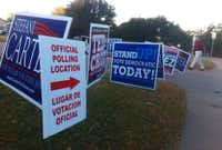 A gaggle of campaign signs compete for attention Tuesday morning outside the polling place at Aikin Elementary in northeast Dallas.(Louis DeLuca)