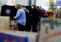 Voters cast their ballots Tuesday at Sherrod Elementary School in Arlington. (David Woo/Staff Photographer)