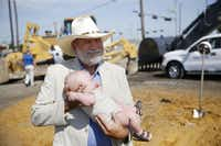 J.R. Wade held 3-month-old Lenox Burge, the youngest member of the Wade family, after Wednesday's groundbreaking for Wade Park. Land once farmed by the Wade family will be home to retail space, office towers, homes, hotels, restaurants and entertainment venues.( Andy Jacobsohn  -  Staff Photographer )
