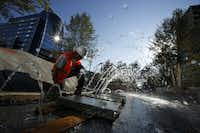 Construction worker Jesus Solorzano tests a water feature at the park. The park represents 10 years of planning, $110 million in funding and a fundamental shift in the way people think about urban life.