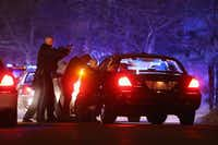 Police search for a suspect in Watertown, Mass. Earlier, a Massachusetts Institute of Technology campus police officer was shot and killed late Thursday night at the school's campus in Cambridge.