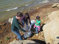 Three volunteers pick up trash at one of GLC's annual waterway cleanups. The organization performed these cleanups regularly in Highland Village and Lewisville.Photos submitted by STACEY CAMPBELL