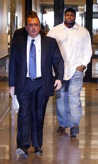 Dallas Cowboys nose tackle Josh Brent is escorted by his attorney George Milner at the Dallas County 195th District Court on Tuesday.