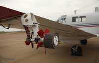This attachment to the Beechcraft aircraft will disperse the pesticide.