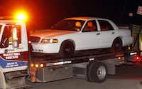 Authorities removed a Ford Crown Victoria after conducting a search of a storage unit in Seagoville on Saturday.