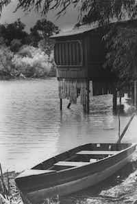 A rowboat sits beached near one of the many boat houses that once were common around White Rock Lake. In 1929, White Rock Lake Park was created when the city transferred the land to the Park and Recreation Department. Dallas Water Utilities remained responsible for the water, dam and spillway.