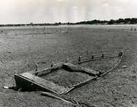 A mini-drought in August 1970 revealed the skeleton of a sunken boat embedded in the parched lakebed.