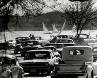 Cars cruising around White Rock Lake cause a traffic jam in March 1970. East Lawther Drive eventually was converted to one-way traffic to discourage cruising, and it 1979 it was divided into sections so that motorists could no longer drive a continuous route around the lake.